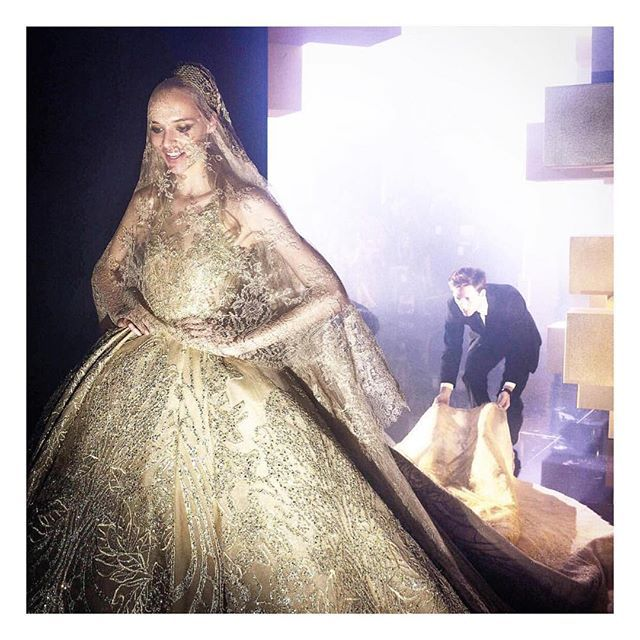 """""""Backstage bride & groom by Elie Saab. Did you know this golden wedding dress was inspired to Saab by his own wife's dress when they got married? Tell us about YOUR (dream) dress! How was it/how do you want it to be? """" Photo taken by @hautearabia on Instagram, pinned via the InstaPin iOS App! http://www.instapinapp.com (07/12/2015)"""