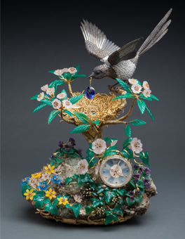 """""""The Magpie's Treasure Nest Clock,"""" made by Patek Philippe in 1992, sold for ($2.5 million) HK$18.04 million, compared with a presale high estimate of HK$5 million. The clock was the most expensive lot in the Sotheby's fine watches sale held on April 7 in Hong Kong that raised HK$221.5 million, the most ever for a Sotheby's sale of timepieces."""