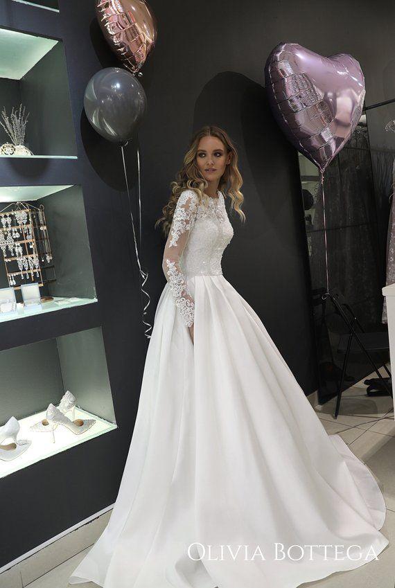 2ff95b146b9a Mikado wedding dress Tviko by Olivia Bottega. Long sleeve wedding dress.  Pockets on skirt. Lace long