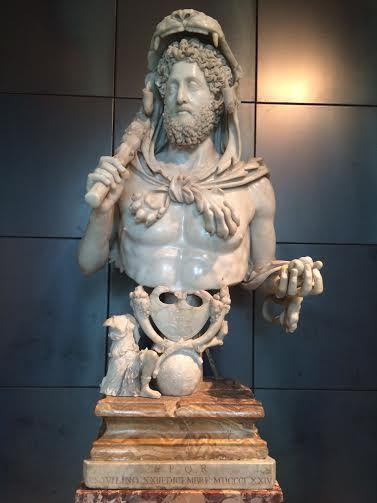 Roma, Musei Capitolini. Busto di Commodo come Ercole. Da Roma, horti Lamiani 192 d. C. In marmo lunense (busto) e alabastro (plinto) / Bust of Commodus as Hercules, from Rome, Horti Lamiani, 192 AD; Carrara marble (bust), alabaster (plinth).