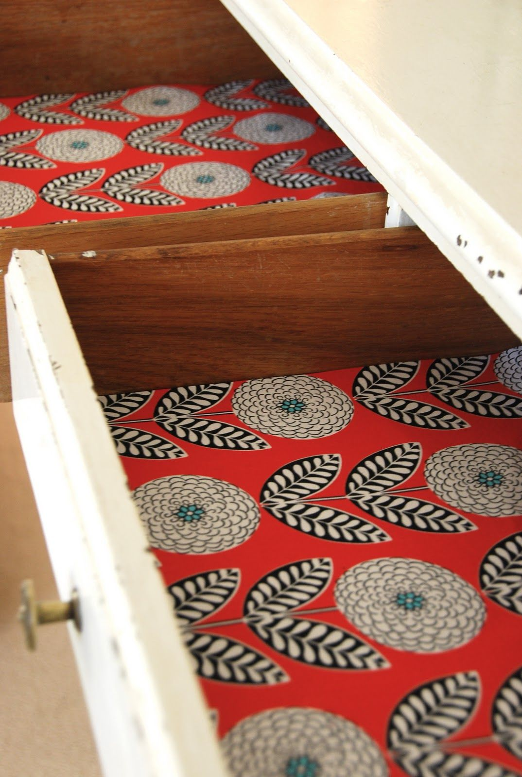 Drawers are generally for storage so no one ever expects the thoughtful pop of design that comes with sticking some wallpaper into the bottom of your