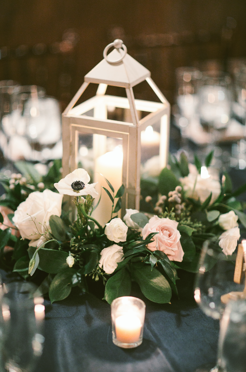 Winter Centerpiece Inspiration White Candle Lantern With Greenery Black And White Anemone Light Pink Wedding White Lantern Centerpieces Pink Winter Weddings