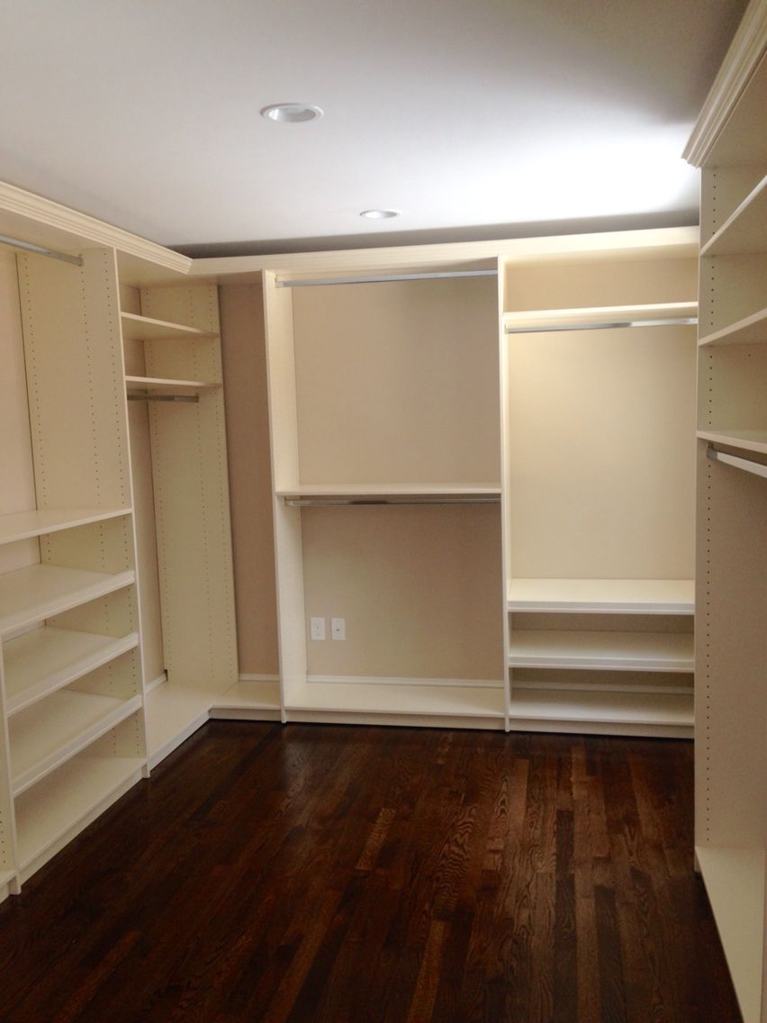 Walk In Closet In Cream With Shoe Shelves And Crown Molding Closets By  Design