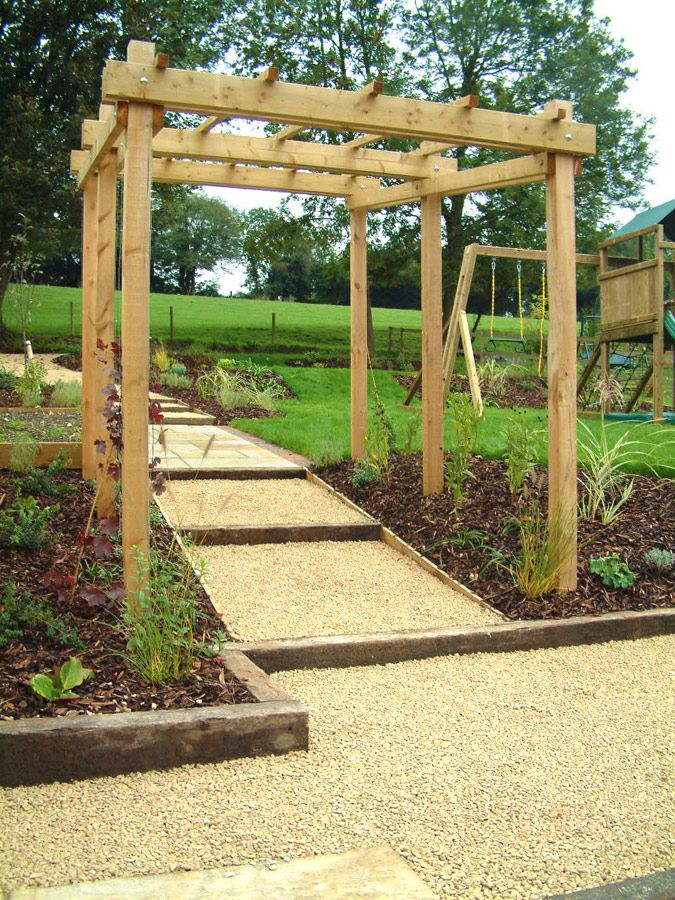 a child friendly steeply sloping plot by woodpecker garden designswoodpecker garden and landscape designs
