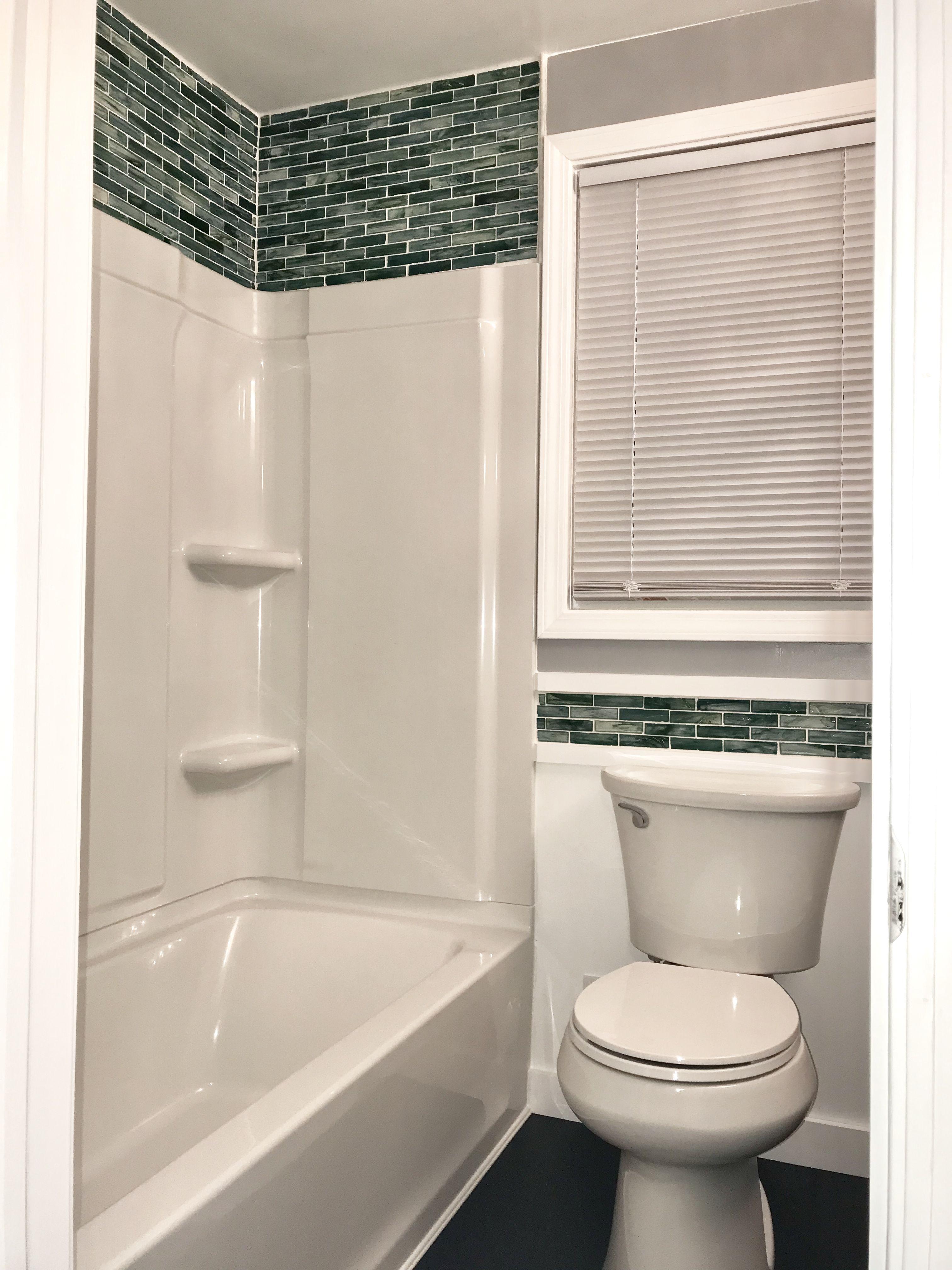 Green glass tile, Sterling Ensemble surround and Kohler Toilet ...