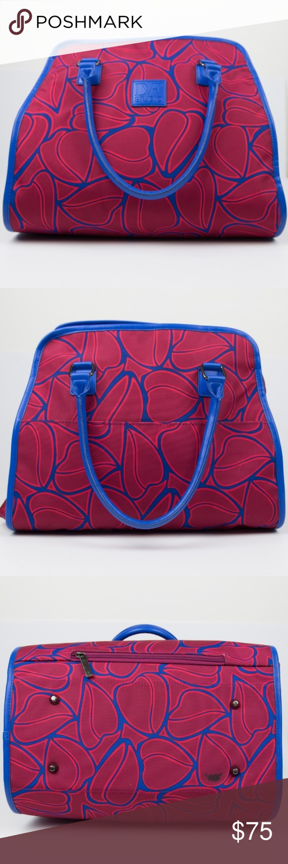 """Diane von Furstenberg Amor Travel Tote Bag Red Diane von Furstenberg DVF Studio """"Amor"""" travel tote. Great carry on/overnight bag for a weekend getaway or to carry on the airplane. Nicely holds a laptop as well. Red and blue with leaf pattern. Dual rolled top handles, zip top closure, trolly sleeve, protective feet, inside has side wall slip pockets and one side wall zip pocket. Good preloved condition. One marker mark on the bottom of the bag, otherwise no noticeable holes, stains or rips. Diane von Furstenberg Bags Totes"""