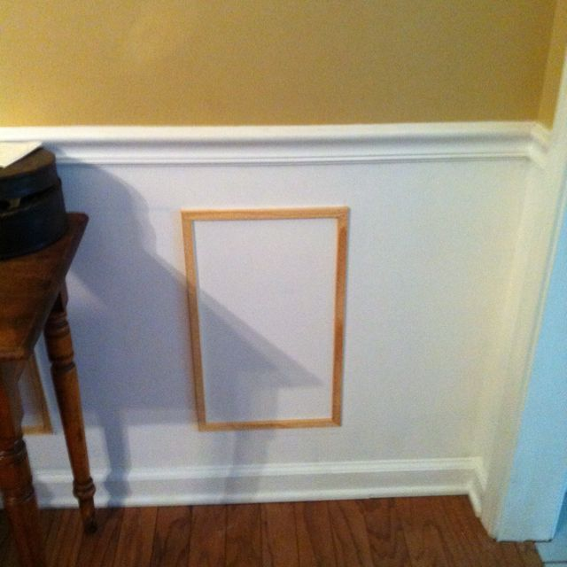 DIY Wainscoting Frames Under The Chair Rail.