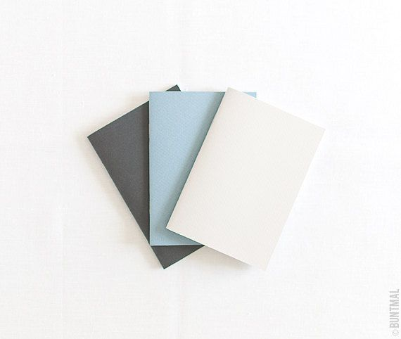 Pastel set of beige blue and black notebooks journals by Buntmal