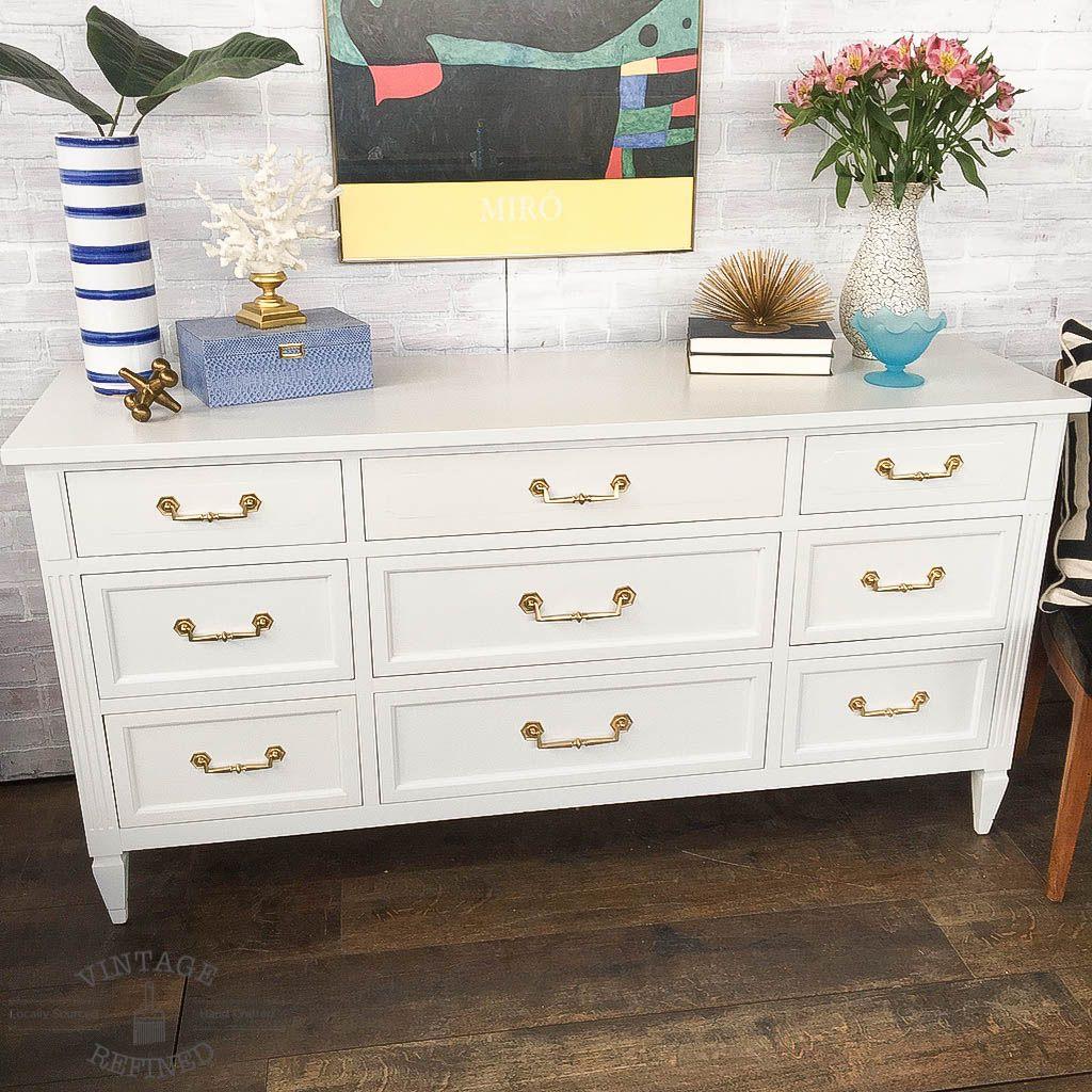 white dresser with gold hardware