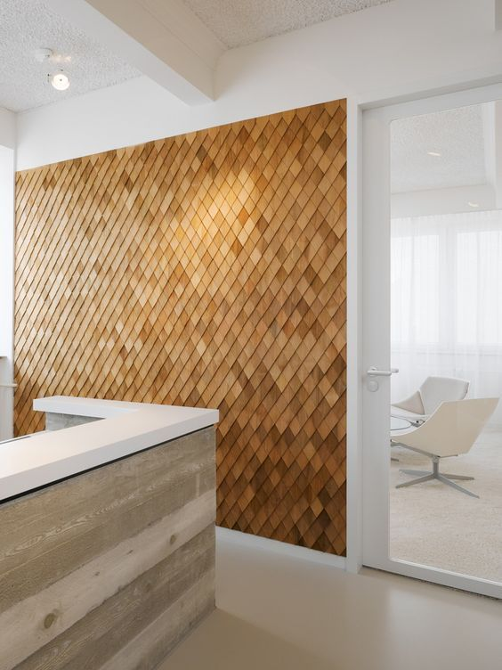 Different way to add wood wall to the lower level. Shingles on diagonal.:
