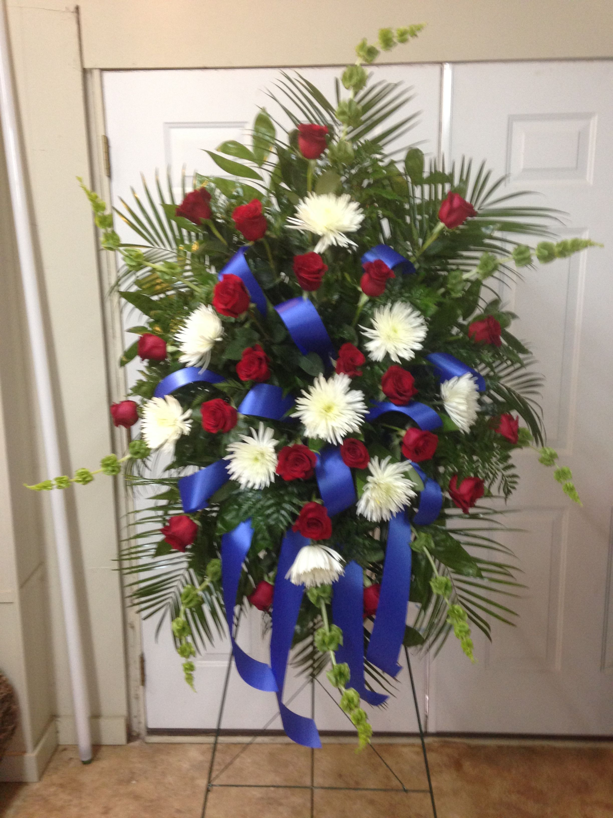 Live funeral spray using bells of ireland white fuji mums and red live funeral spray using bells of ireland white fuji mums and red roses accented with royal blue ribbon veteran funeral smith october 2015 izmirmasajfo