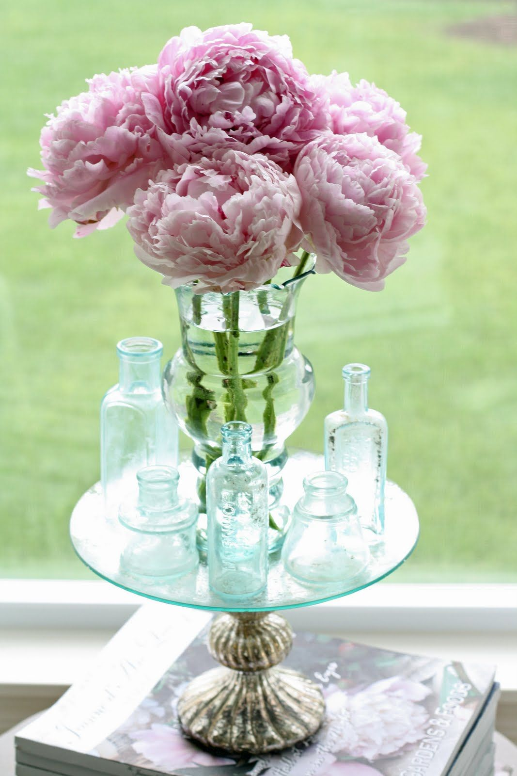 Peonies & bottles on a lovely table
