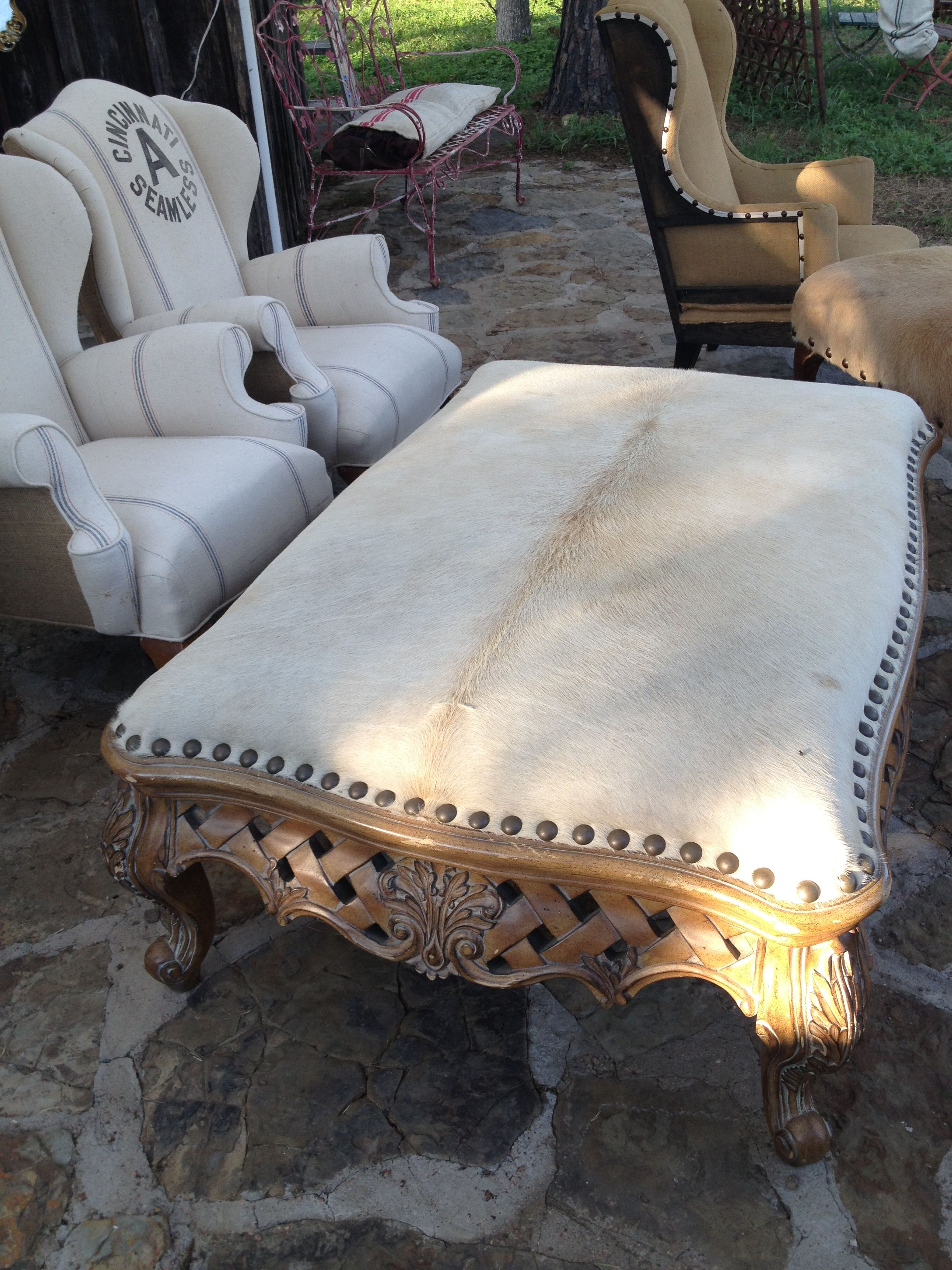 Coffee Table Turned Large Ottoman   Upholstered With White Cowhide And  Large Nailheads.