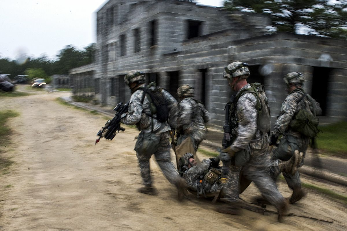 Soldiers move a simulated casualty from one building to another as part of the Combined Joint Operational Access Exercise 15-01 on Fort Bragg, N.C., April 15, 2015,. The soldiers are assigned to the 82nd Airborne Division's 2nd Brigade Combat Team