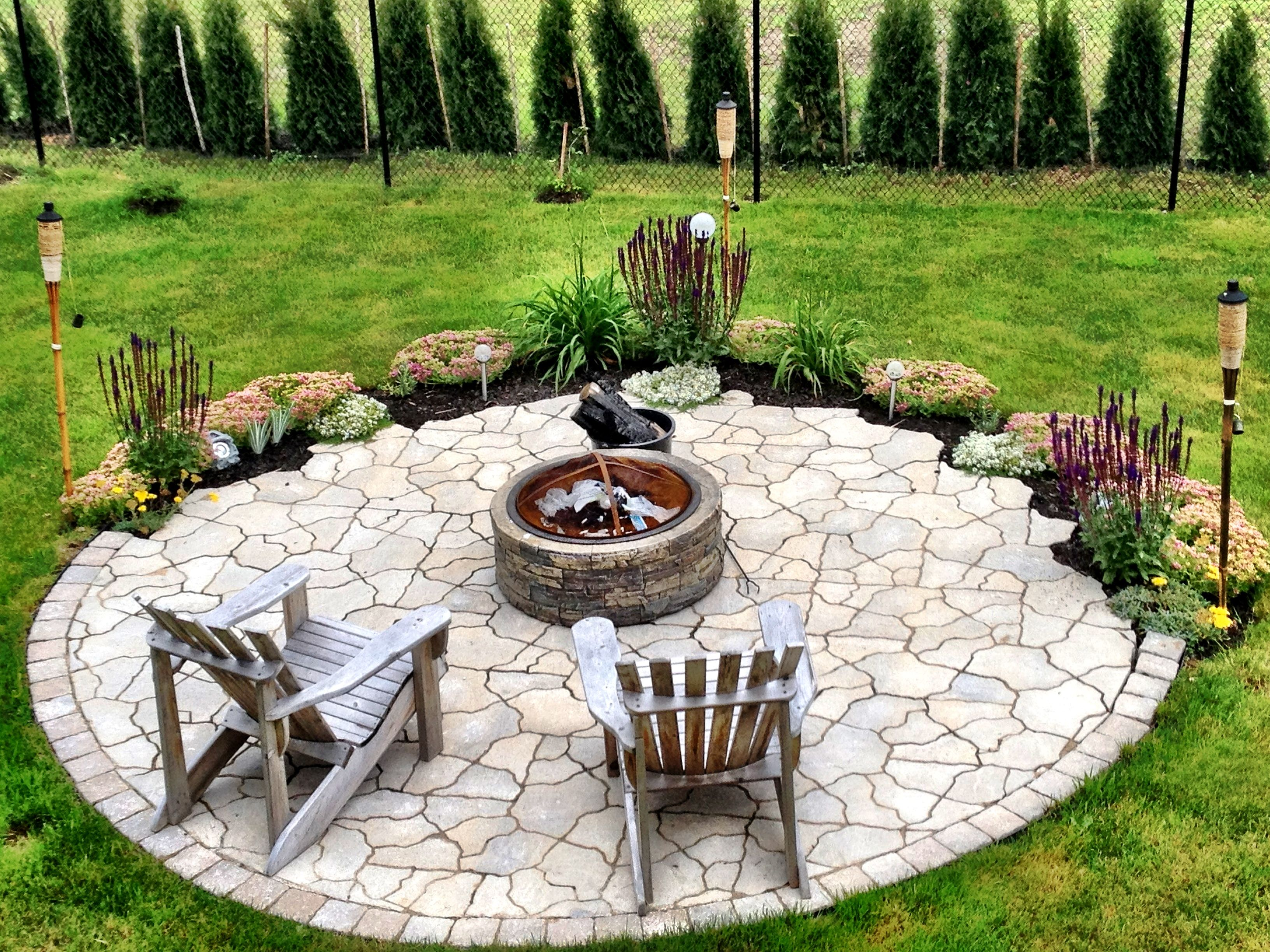 My fire pit garden karen likes the small flower beds on for Flower fire pit
