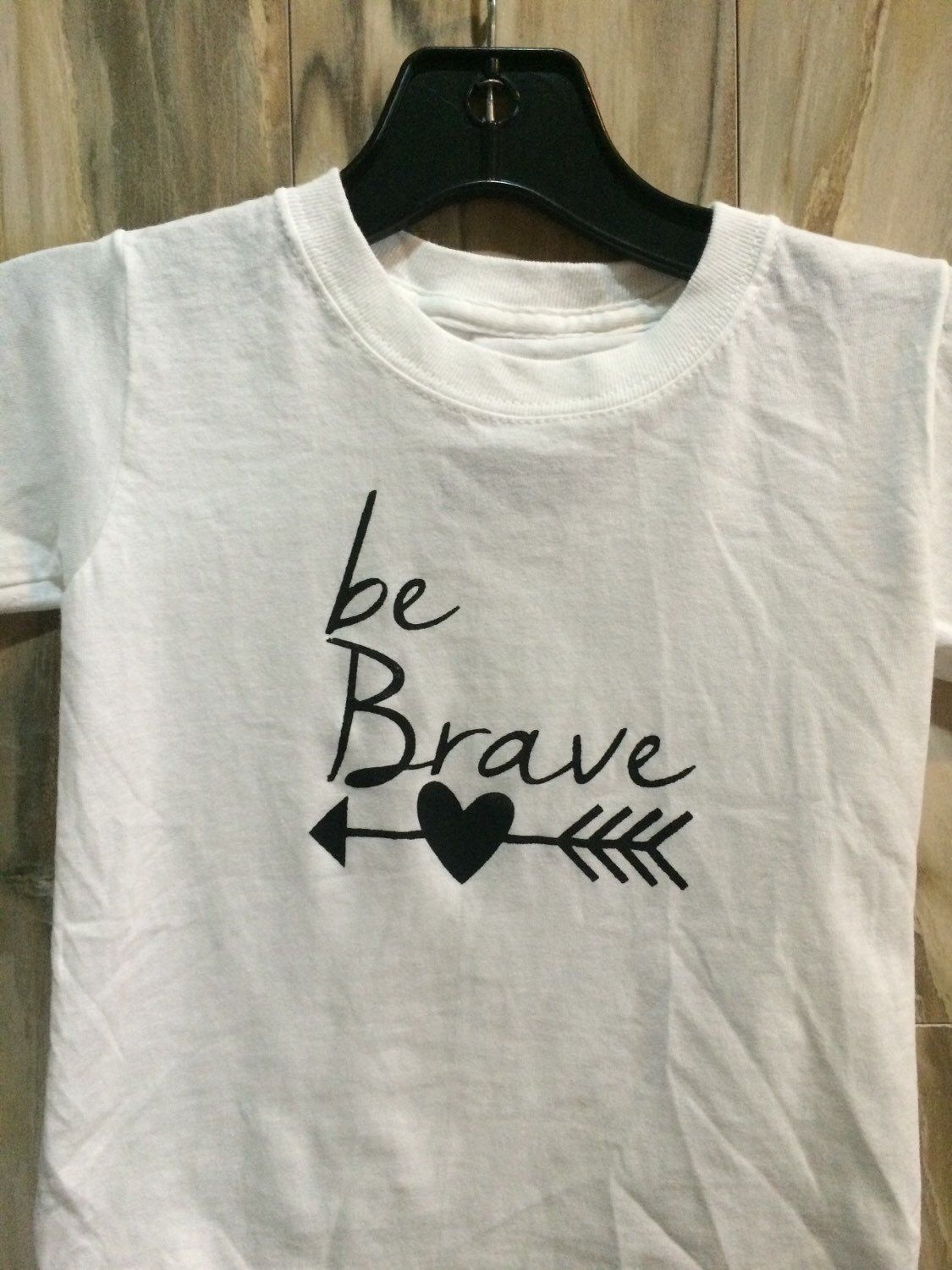 A personal favorite from my Etsy shop https://www.etsy.com/listing/235156454/be-brave-arrow-kids-tee