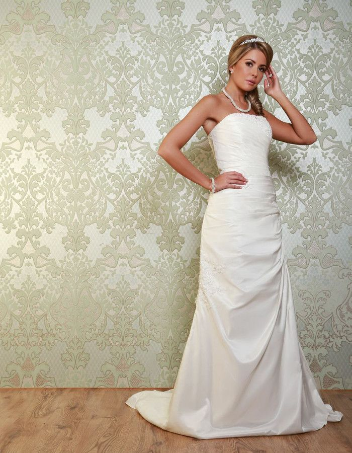 MONROE A pretty asymmetric fishtail style gown with beautiful lace ...