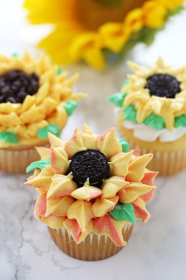 How to Make Sunflower Cupcakes with three different buttercream decorating methods that anyone can do! They're so fun, happy, and beautiful that everyone will think they came from an expensive bakery! #sunflowercupcakes How to Make Sunflower Cupcakes with three different buttercream decorating methods that anyone can do! They're so fun, happy, and beautiful that everyone will think they came from an expensive bakery! #sunflowercupcakes How to Make Sunflower Cupcakes with three different buttercr #sunflowercupcakes