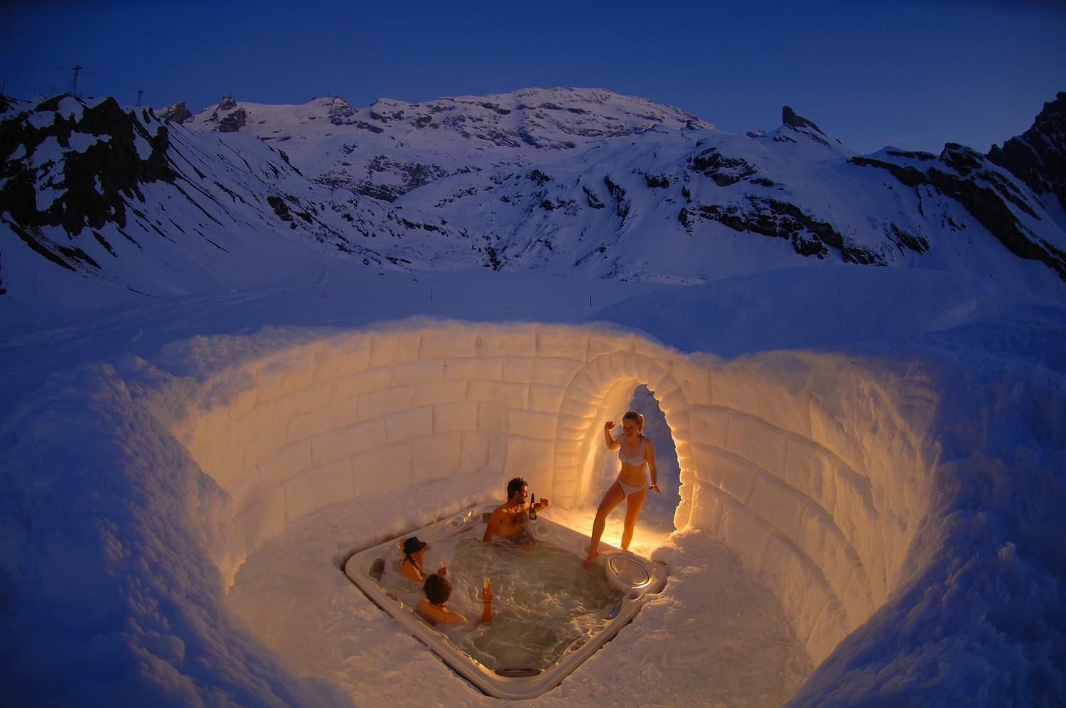 """""""Igloo Jacuzzi"""" by photographer Géraldine Pucken.    This outdoor jacuzzi is part of the Igloo Village, 'Iglu-Dorf', in Zermatt. Guests sleep at an altitude of 2,727 meters (8.946 ft) at the Gornergrat, right next to Switzerland's most famous mountain, the mighty Matterhorn."""