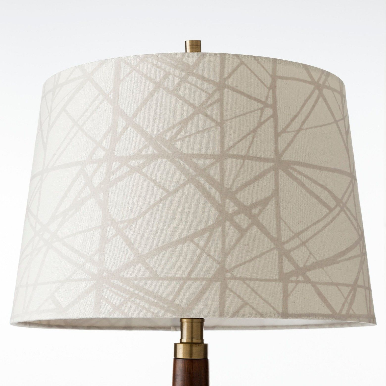 Create your own décor with the Flocked Criss Cross Pattern Replacement Lamp Shade Large - Cream - Threshold. Add a fresh touch to your tired old décor by changing the lampshade on a favorite lamp base or start out with a mix and match style that is uniquely yours. You'll love the options you now have to let your personal aesthetic shine.