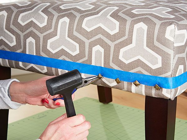 Whether the piece of furniture is store-bought or upholstered by you, add personality by trimming the edges with tacks.