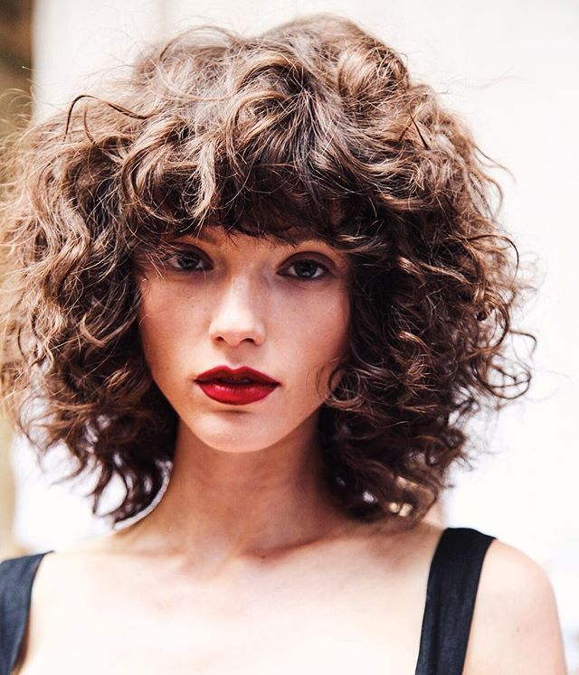 Short Curly Hair With Bangs And Layers 8