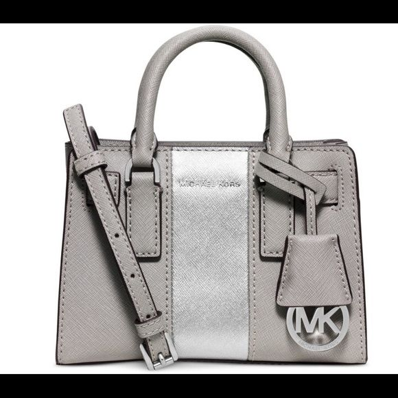 """‼️ Michael Kors Mini Dillon crossbody Super cute Michael kors mini Dillon. ‼NO TRADES‼️ PRICE IS FIRM HERE‼️ Brand new, never used. 100% authentic. Cheaper on Ⓜ️$ Saffiano leather; silver-tone hardware 7"""" W x 3"""" H x 5"""" D Double handles with 3"""" drop; adjustable crossbody strap with 24"""" drop Top zip closure Signature interior features 1 slip pocket Michael Kors Bags Crossbody Bags"""