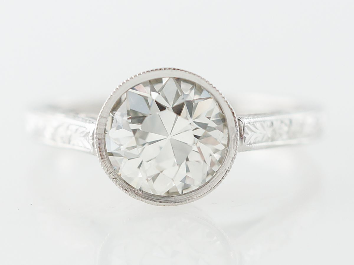 Photo of Art Deco Bezel Solitaire Engagement Ring in Platinum
