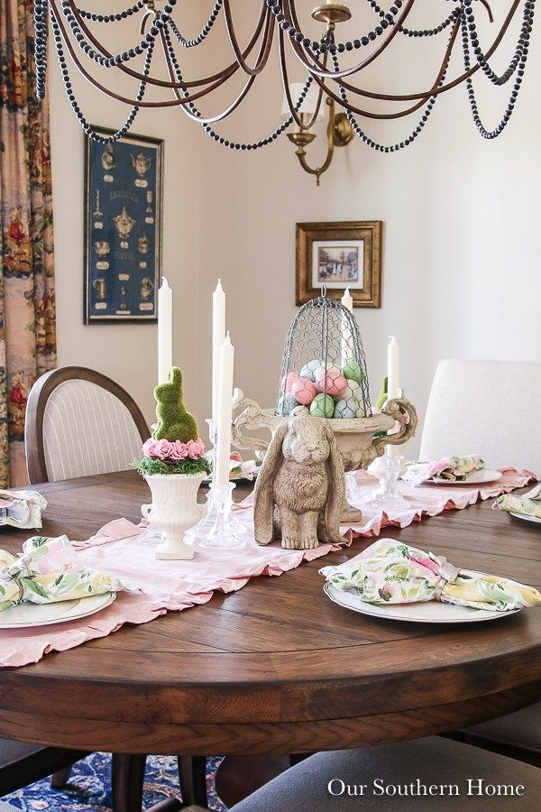 French Farmhouse dining room decked out for the Easter holiday! #easterdecor #eastertable #eastertablescape #springdecor #springdecorating #farmhouse #frenchcountry