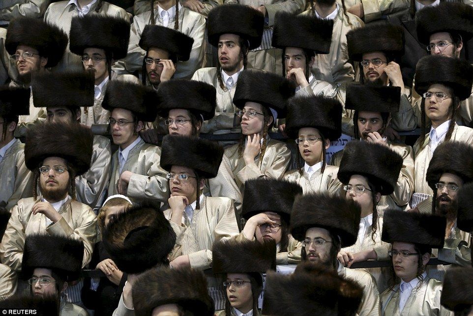 The Jewish Men Attend Wedding In Traditional Shtreimel Hats As They Watch Proceedi
