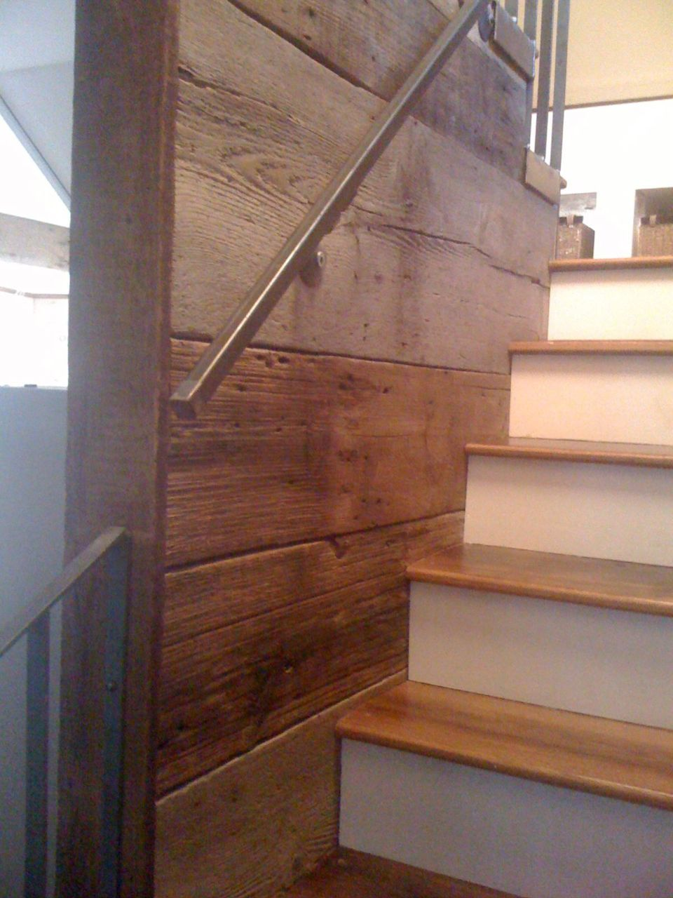 Barn siding and reclaimed chestnut stair treads. Great stairwell idea!