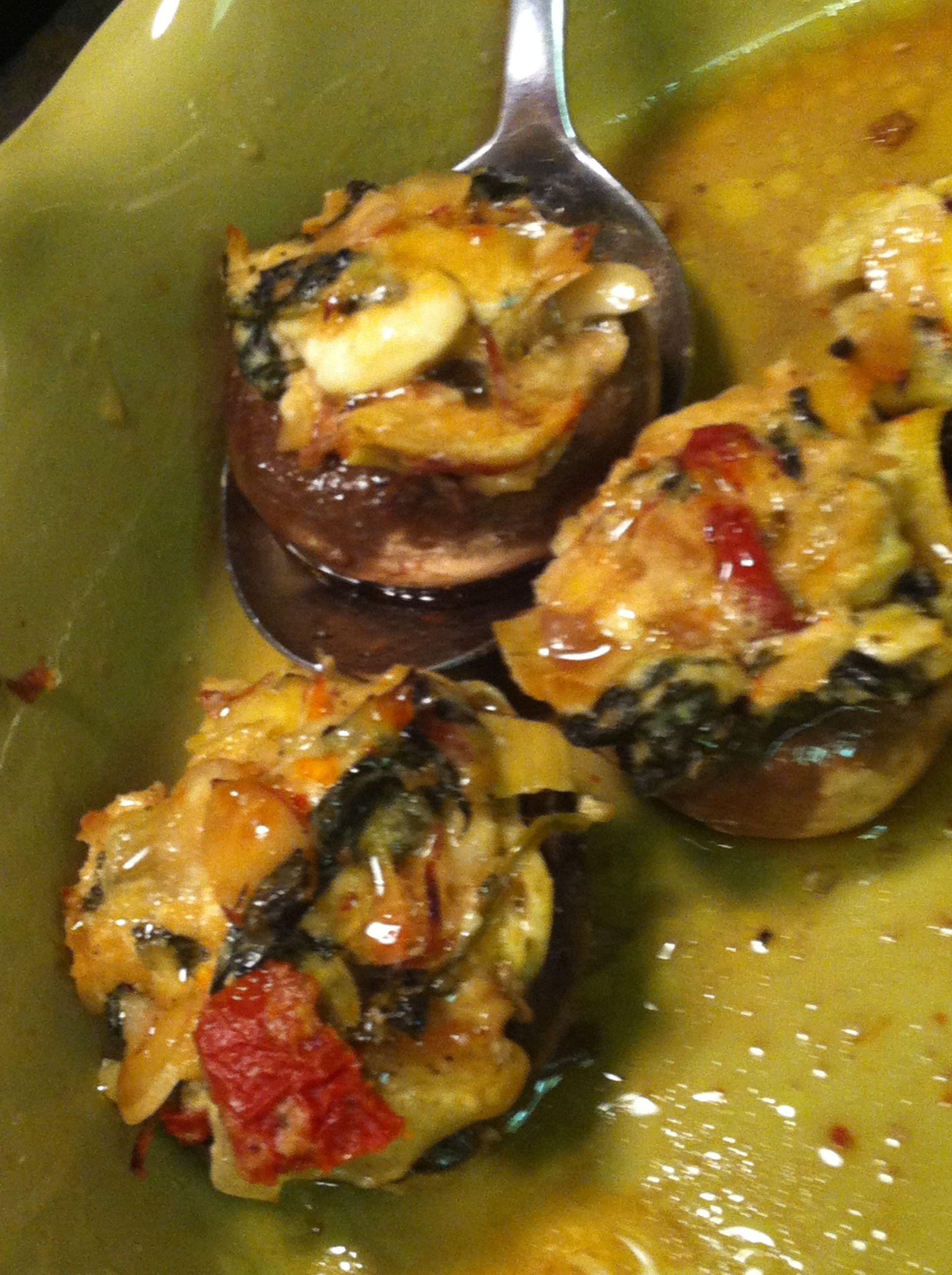 Artichoke and sun dried tomato stuffed mushrooms - stuff mushrooms with leftover artichoke dip! Too easy