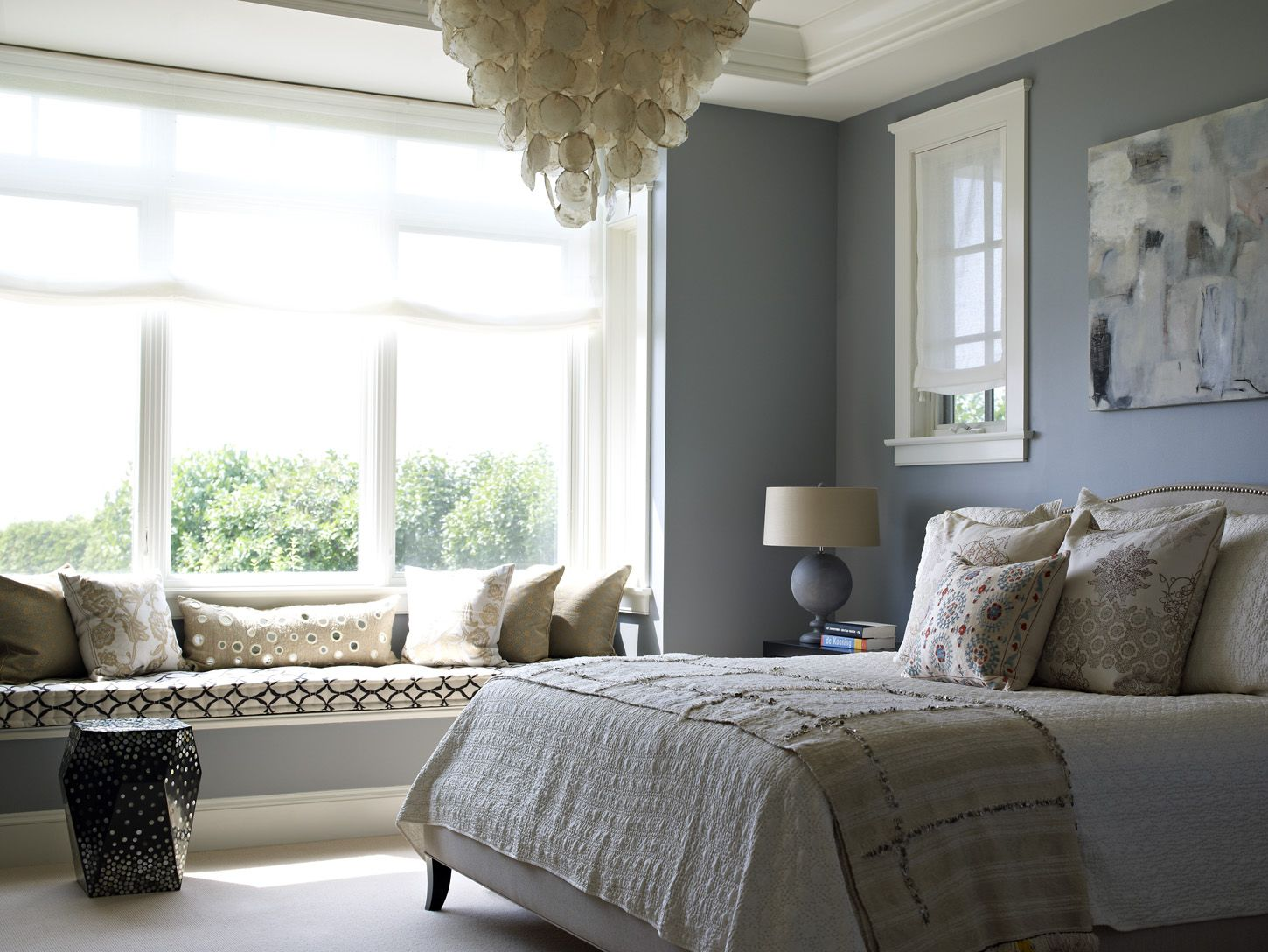Calm Bedroom Colors blue & cream bedroom with colette nailhead-trimmed bed, capiz