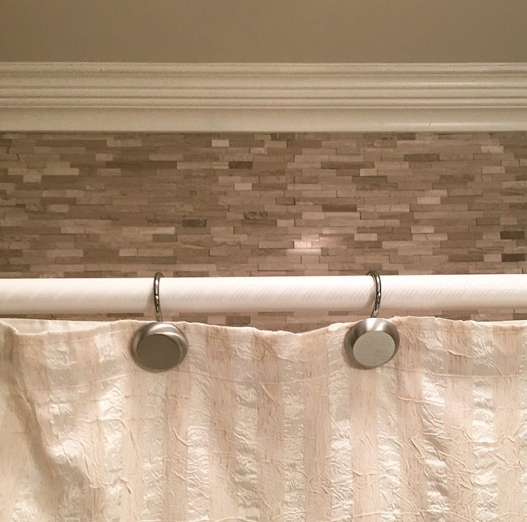 Tile above bath/ shower insert in guest bath. These are peel and ...