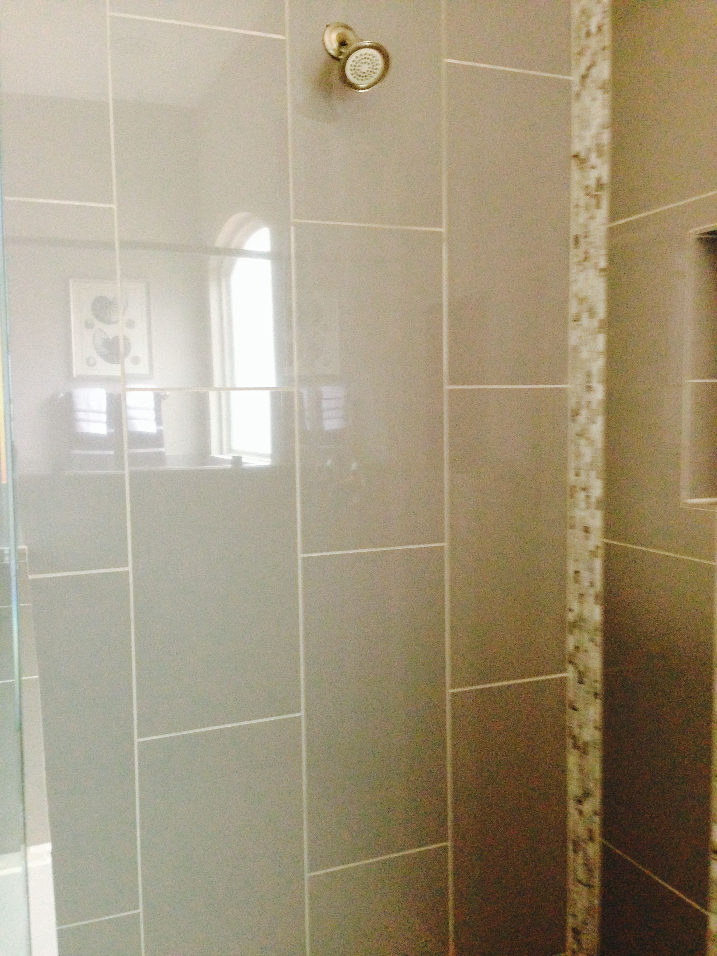 portland custom pattern masterbath living condo beige staggered tile surround joint floor offset shower