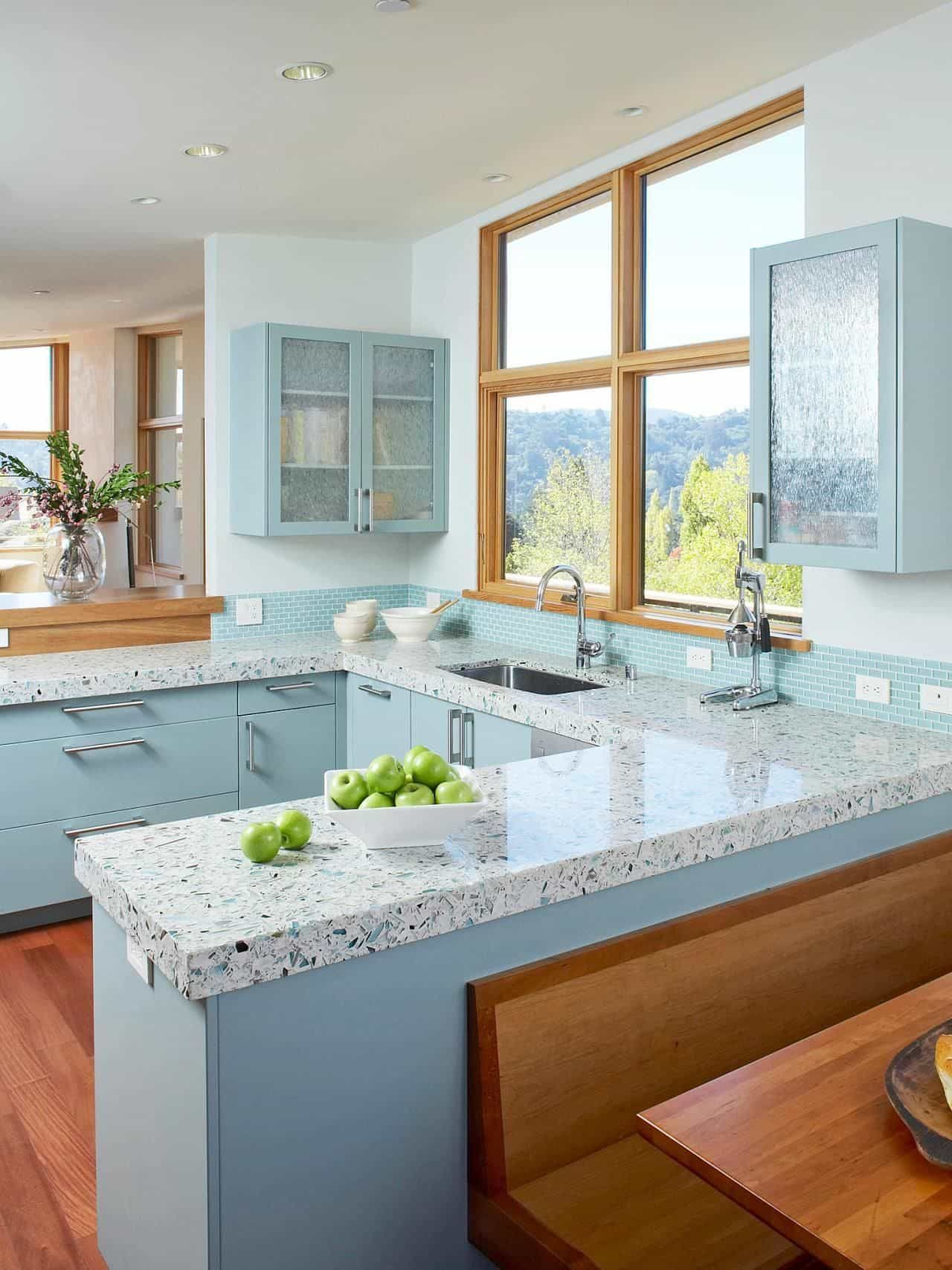 U Shaped Kitchen With Turquoise Cabinets And Granite Countertops