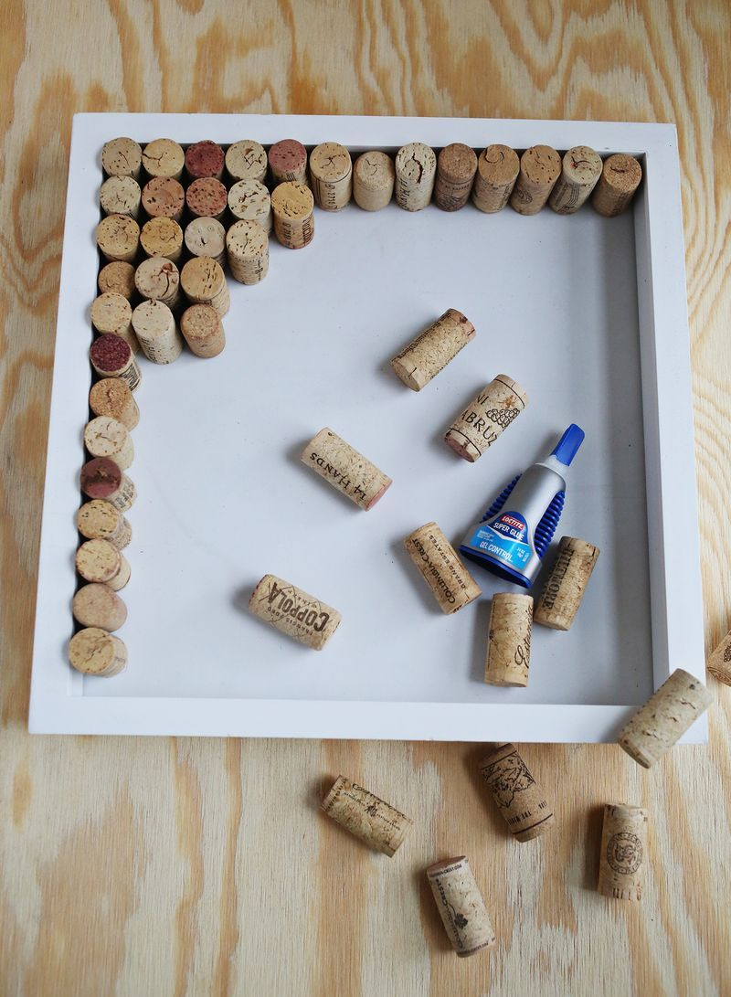 How to make a wine cork bulletin board from a shadow box for Diy cork board