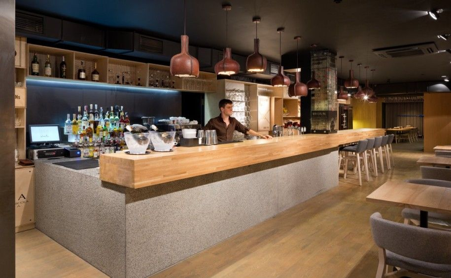 Restaurant Kitchen Bar Design the restaurant bar with wooden pendant lights. #lights