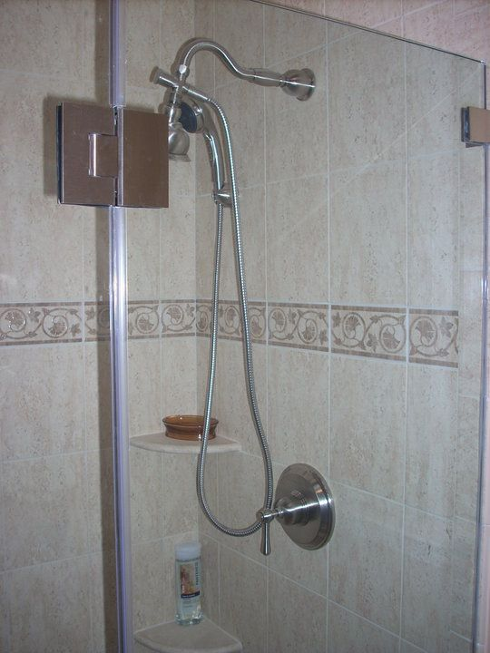 Danze Brushed Nickel Shower System With Victorian Shower Head.