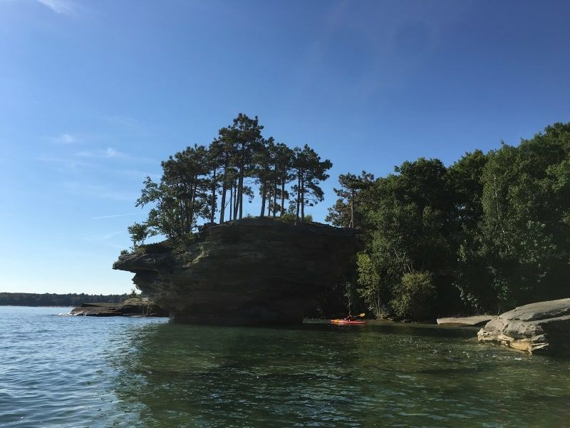 It's a small geological formation in Michigan. It is a limestone stack located in Lake Huron, in shallow water a few meters offshore, near the rock called the Thumbnail which is the extreme tip of Pointe Aux Barques, a small peninsula in Pointe Aux Barques Township which in turn is the extreme tip of The Thumb.Turnip Rock has been severely undercut by wave action,so that its top has a significantly larger cross-section than its base. Its consequent unusual form, reminiscent of a turnip, has…