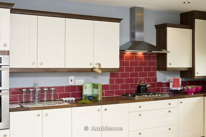 Ambience Images Kitchen With Red Tiled Wall And Cream Presses Hob Extractor Fan
