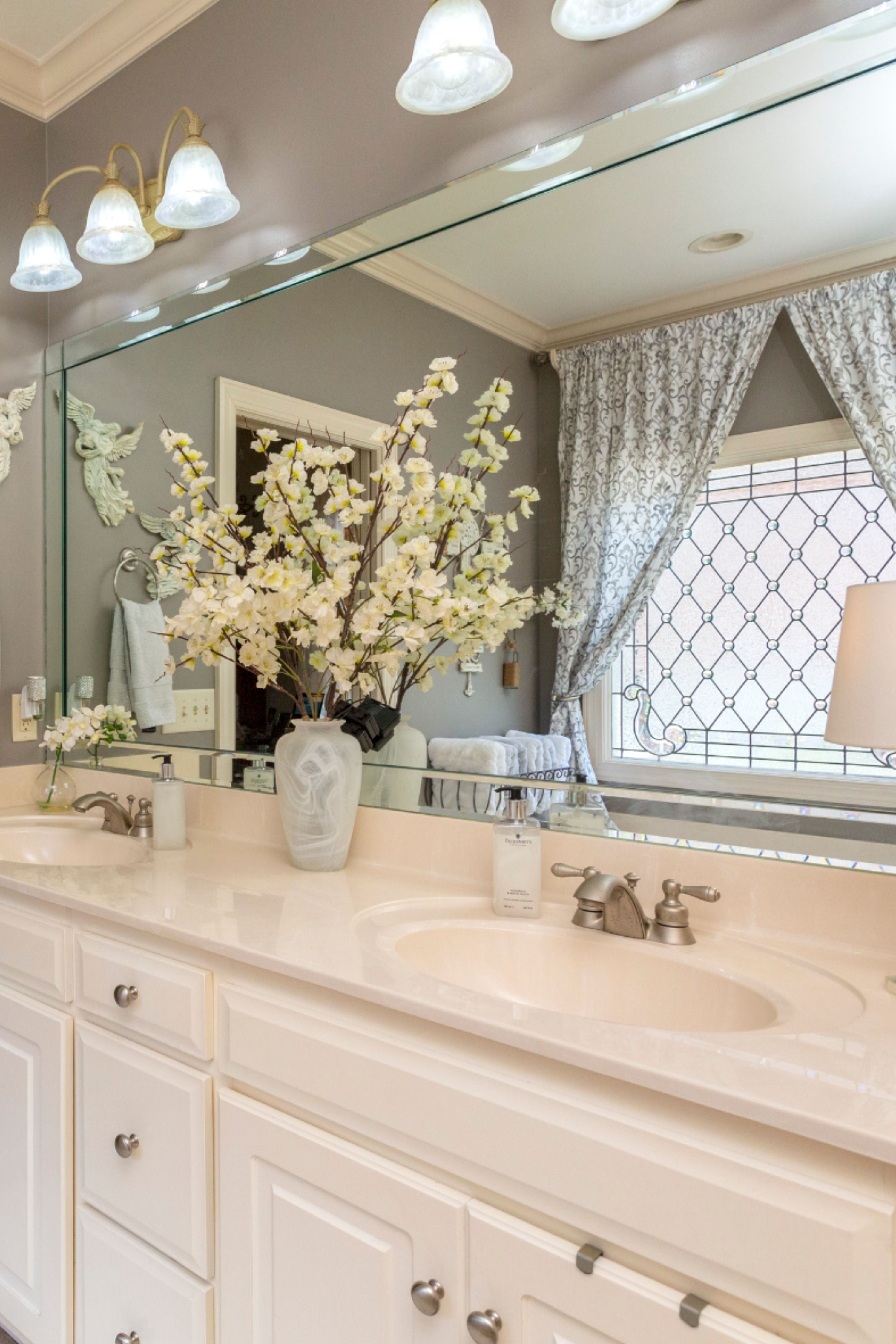 White and grey bathroom with beautiful natural light in