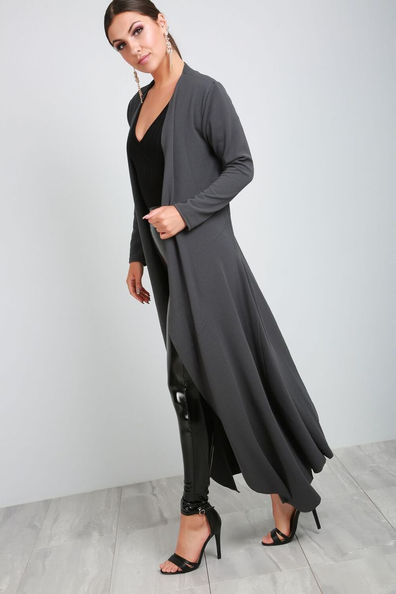 775577a393 Take your look to next level this season with our stylish maxi jacket.  Featuring long sleeves and floaty hem