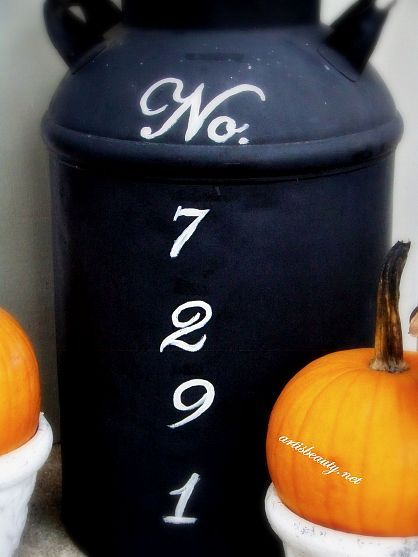 an old antique milk can turned address marker!