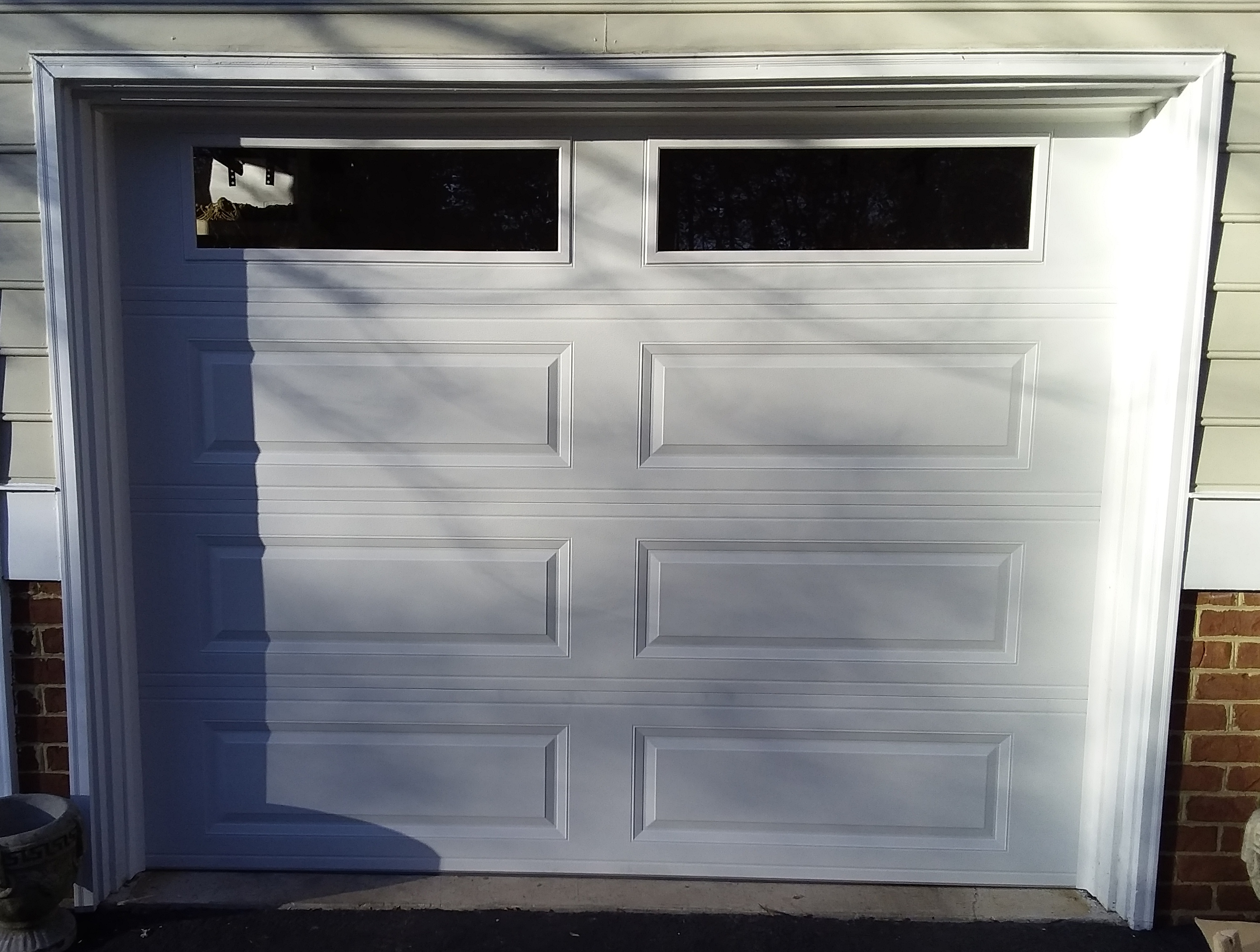 9x7 Model 4251 Raised Long Panel Garage Door Installed By The Richmond Store Teamappledoor Garage Doors Door Installation Garage Door Panels