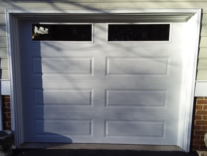 9x7 Model 4251 Raised Long Panel Garage Door Installed By The Richmond Store Teamappledoor Garage Doors Door Installation Garage Door Panels