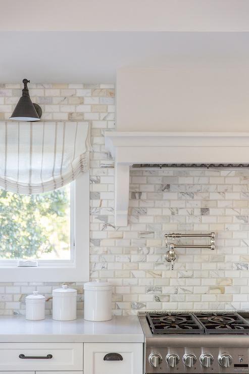 Calcutta Gold Marble Beveled Brick Backsplash Tiles In A