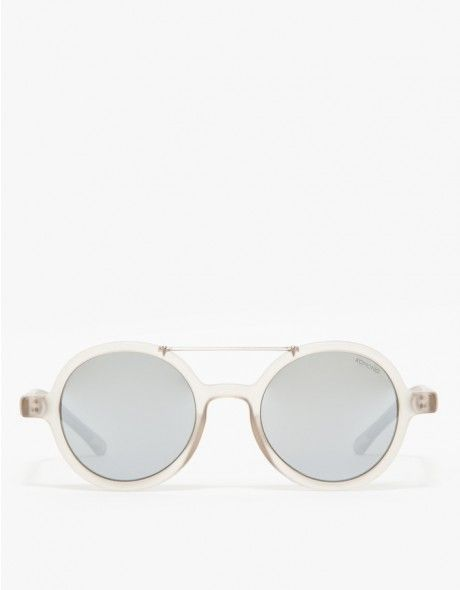 83296c7dfdfc Retro-style rounded frames in a reflective tint from Komono. Features UV400  Protection,