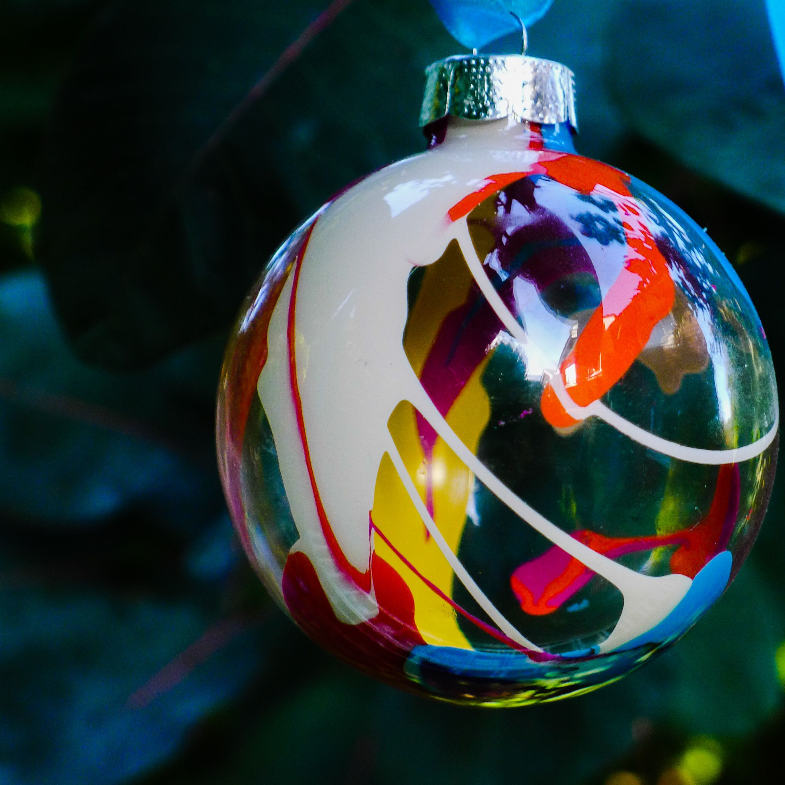 First Batch Of Clear Glass Ornaments Made By Dropping Acrylic Paint Inside Clear Glass Clear Glass Ornaments Christmas Projects For Kids How To Make Ornaments