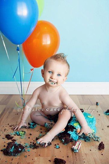 First birthday portrait. Cute, buuuut, I'd never put a cake on my floor. Sorry, as cute as it may be, I'm not cleaning up frosting on the floor. Unless it was your house. :)